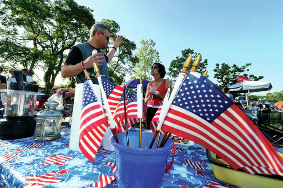 Rowaytonites enjoy the Independence Day celebration at Bailey Beach Thursday.Hour photo / Erik Trautmann / (C)2013, The Hour Newspapers, all rights reserved