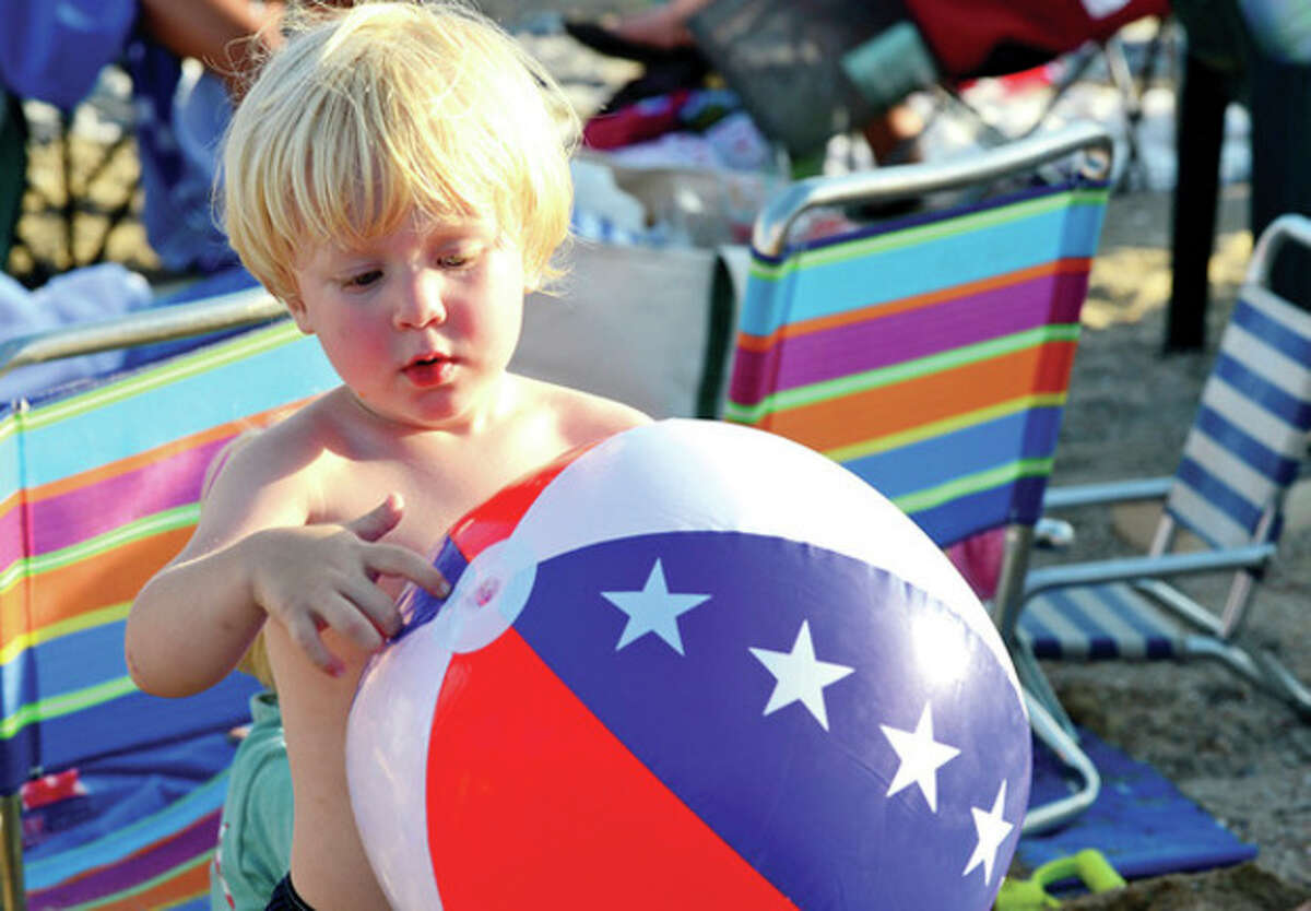 Rowaytonites including three year old Nico Rolfert enjoy the Independence Day celebration at Bailey Beach Thursday. Hour photo / Erik Trautmann