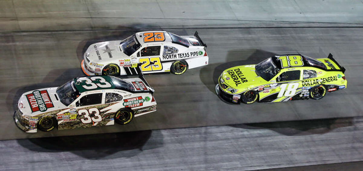 Joey Logano (18) follows Robert Richardson Jr. (23) and Kevin Harvick (33) through a turn during the Food City 250 NASCAR Nationwide Series auto race on Friday, Aug. 24, 2012, in Bristol, Tenn. Logano won the race. (AP Photo/Mark Humphrey)