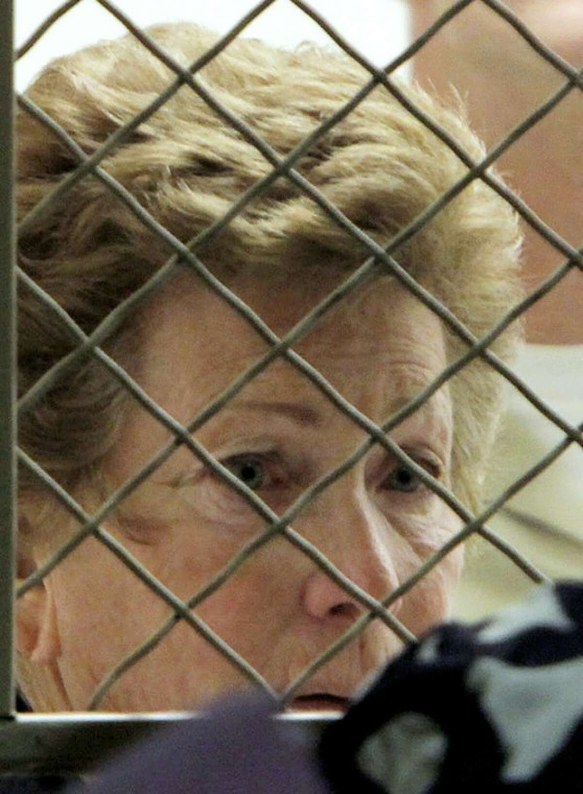 Lois Goodman looks towards her attorney, Allison Triessl as her arraignment on murder charges is postponed Friday Aug. 24, 2012, in Los Angeles. Goodman, professional tennis referee, has been accused of murdering her 80-year-old husband. (AP Photo/Nick Ut)