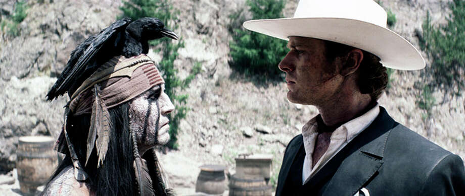 """This film publicity image released by Disney shows Johnny Depp as Tonto, left, and Armie Hammer as The Lone Ranger, in a scene from """"The Lone Ranger."""" (AP Photo/Disney Enterprises, Inc.) / Disney"""