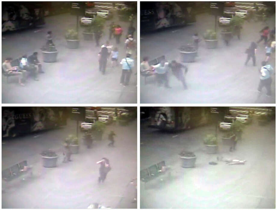 In this sequence of images taken from a surveillance video camera and released by the New York City Police Department, police officers approach Jeffrey Johnson, after he shot his former colleague Steven Ercolino, near the Empire State Building in New York, Friday, Aug. 24, 2012. Johnson, upper left in frames, was shot and killed by police as bystanders fled. (AP Photo/New York City Police Department) / New York City Police Department