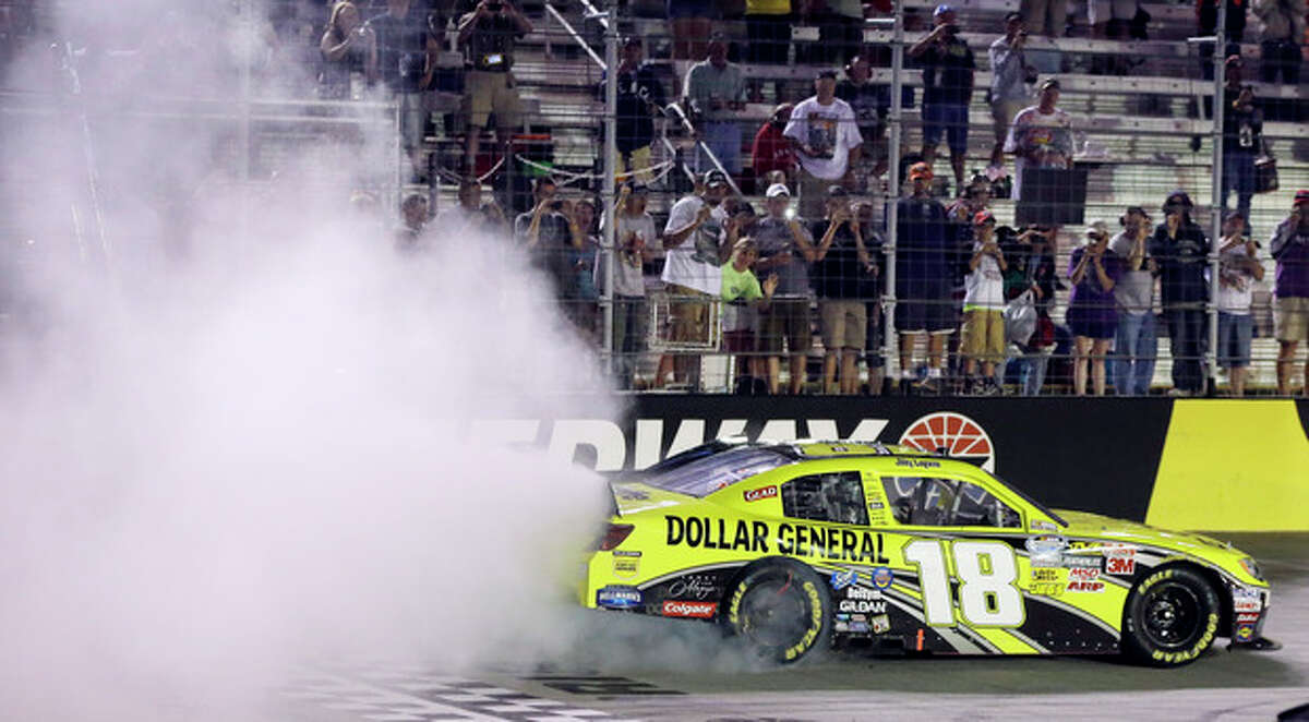 Joey Logano does a burnout after winning the Food City 250 NASCAR Nationwide Series auto race on Friday, Aug. 24, 2012, in Bristol, Tenn. (AP Photo/Mark Humphrey)