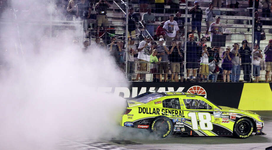 Joey Logano does a burnout after winning the Food City 250 NASCAR Nationwide Series auto race on Friday, Aug. 24, 2012, in Bristol, Tenn. (AP Photo/Mark Humphrey) / AP