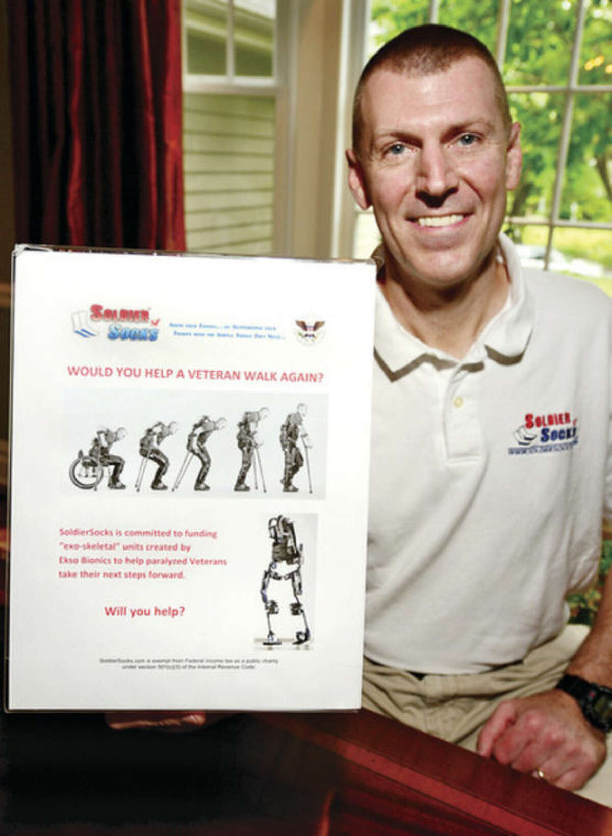 Hour photo / Erik Trautmann Stamford resident Chris Meek, founder of the Soldier Socks program, has created a fundraiser for veterans who can no longer walk and is helping to provide a tool to help them walk again.