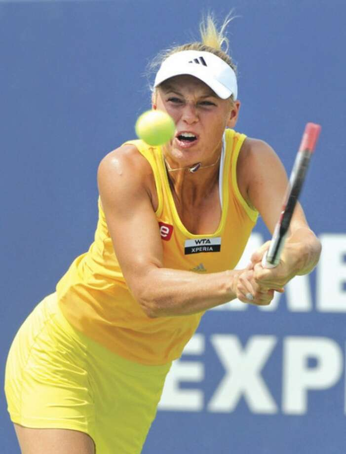 AP photoCaroline Wozniacki hits a backhand during her semifinal match against Maria Kirilenko Friday at the New Haven Open. The four-time defending champ, Wozniacki retired due to a knee injury after dropping the first set to Maria Kirilenko.