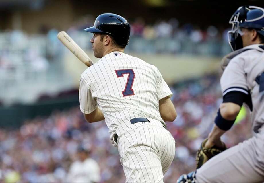 Minnesota Twins' Joe Mauer hits an RBI-double off New York Yankees pitcher CC Sabathia in the third inning of a baseball game on Wednesday, July 3, 2013, in Minneapolis. (AP Photo/Jim Mone) / AP