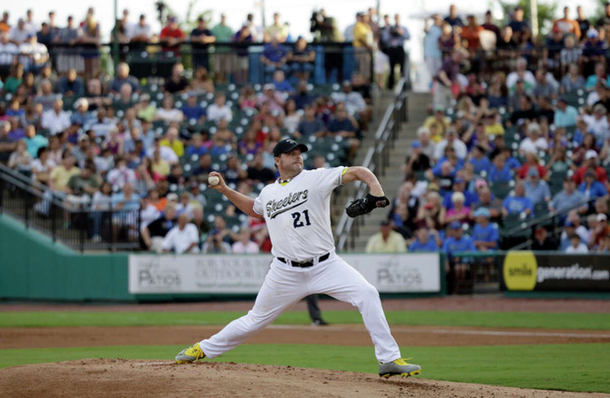 Sugar Land Skeeters Roger Clemens throws a pitch during a baseball game against the Bridgeport Bluefish Saturday, Aug. 25, 2012, in Sugar Land, Texas. Clemens, a seven-time Cy Young Award winner, signed with the Skeeters of the independent Atlantic League this week. (AP Photo/David J. Phillip)