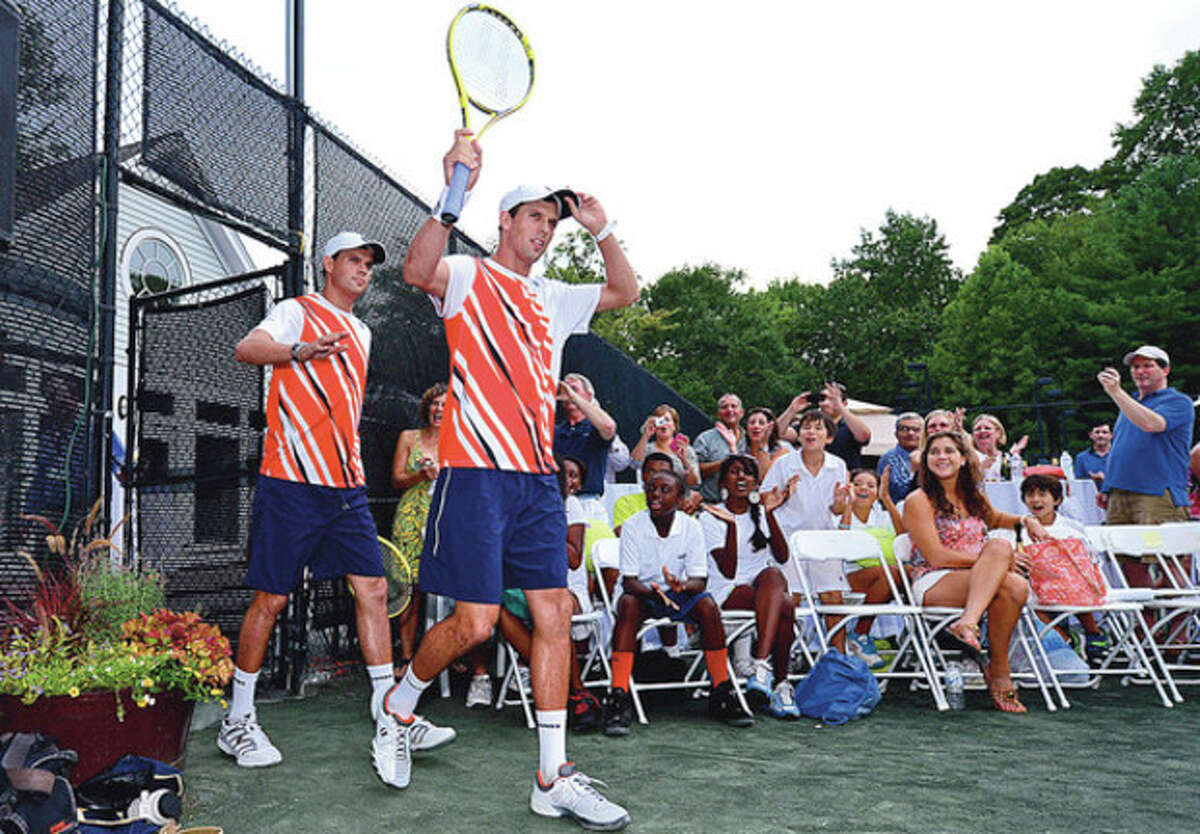 Hour photo/Erik Trautmann Olympic gold medalists and three-time U.S. Open champions Bob and Mike Bryan walk toward the court at the Lake Club in Wilton Saturday for a professional tennis exhibition. Some of the proceeds from the benefit program went to Norwalk Grassroots Tennis.