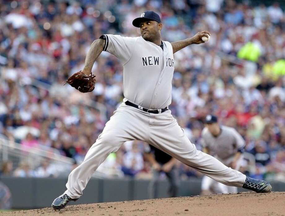 New York Yankees pitcher CC Sabathia throws against the Minnesota Twins in the first inning of a baseball game on Wednesday, July 3, 2013, in Minneapolis. (AP Photo/Jim Mone) / AP