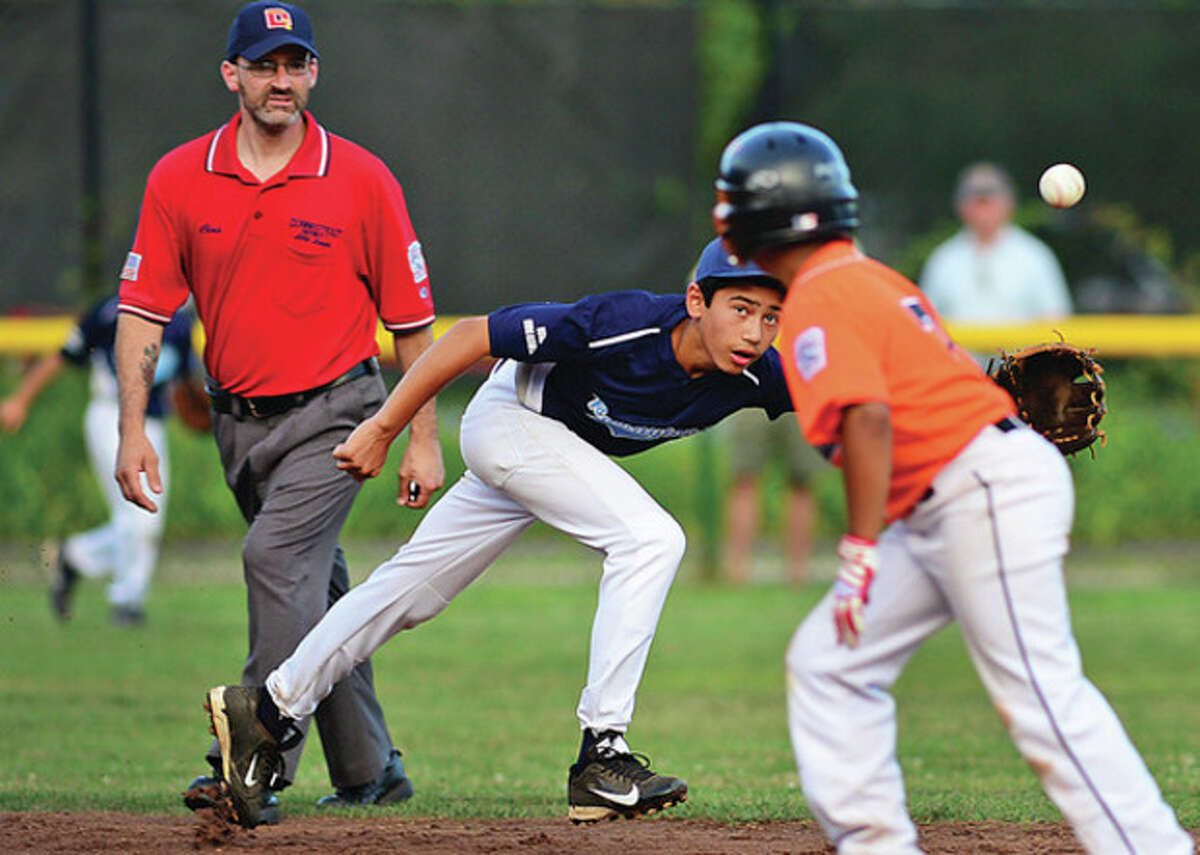 Hour photo/Erik Trautmann Rowayton Little League All-Star Ethan Blattman tries to flag down a grounder during a District 1 playoff game against Ridgefield National on Wednesday. Rowayton dropped a 4-2 decision.