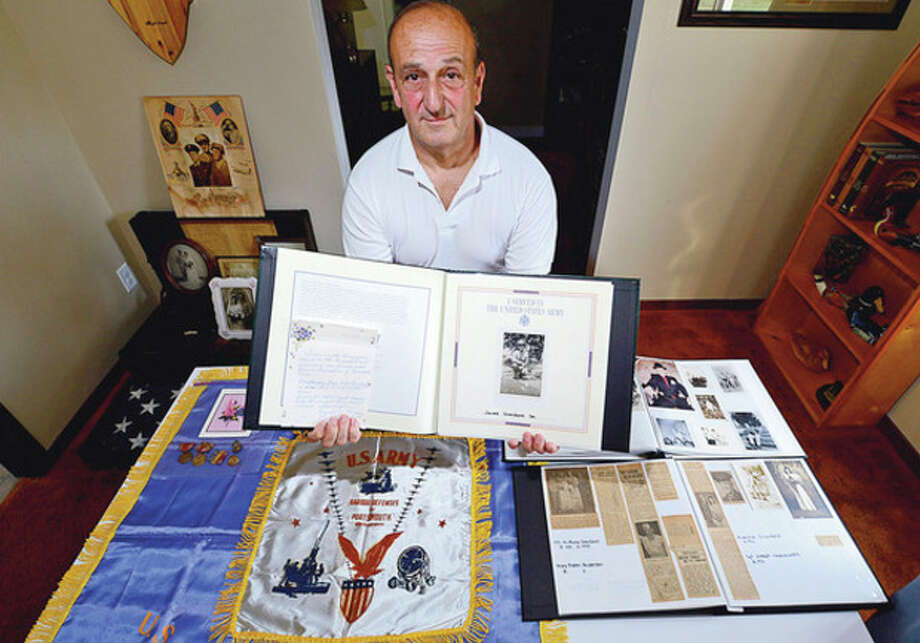 Hour photo / Erik TrautmannSixty-seven years after World War II ended, 92-year-old veteran from New Hampshire, Everett Hersom, reached out to Norwalk in search of his former U.S. Army buddy, James Giordano, who died in 1991. His son, Jim Giordano Jr., shown above, answered the letter and has shared life stories with the veteran about his late father.
