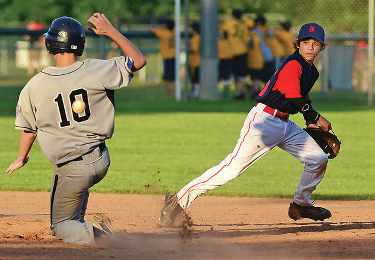 Hour photo / Erik Trautmann Norwalk Babe Ruth 13-year-old All-Stars second baseman Mike Claps tracks down a late throw as Wilton base runner slides safely into second during Friday's Norwalk-Wilton Babe Ruth tournament game at Unity Park in Trumbull Friday.