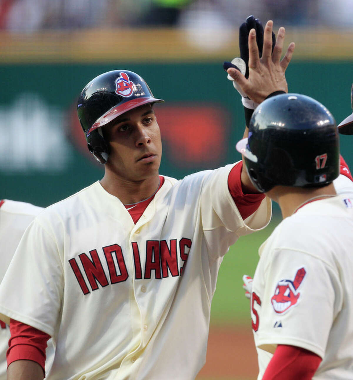 Cleveland Indians' Michael Brantley, left, is congratulated by Shin-Soo Choo after Brantley hit a three-run home run off New York Yankees starting pitcher Hiroki Kuroda in the first inning of a baseball game, Saturday, Aug. 25, 2012, in Cleveland. (AP Photo/Tony Dejak)