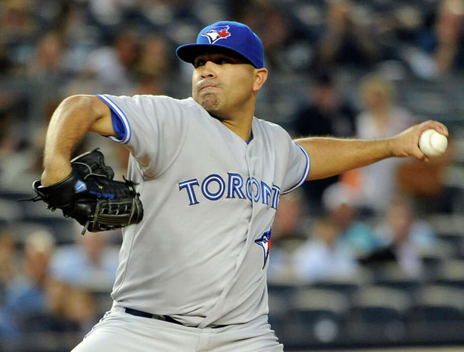 Toronto Blue Jays starting pitcher Ricky Romero throws against the New York Yankees in the second inning of a baseball game on Tuesday, Aug., 28, 2012, in New York. (AP Photo/Kathy Kmonicek) / FR170189 AP