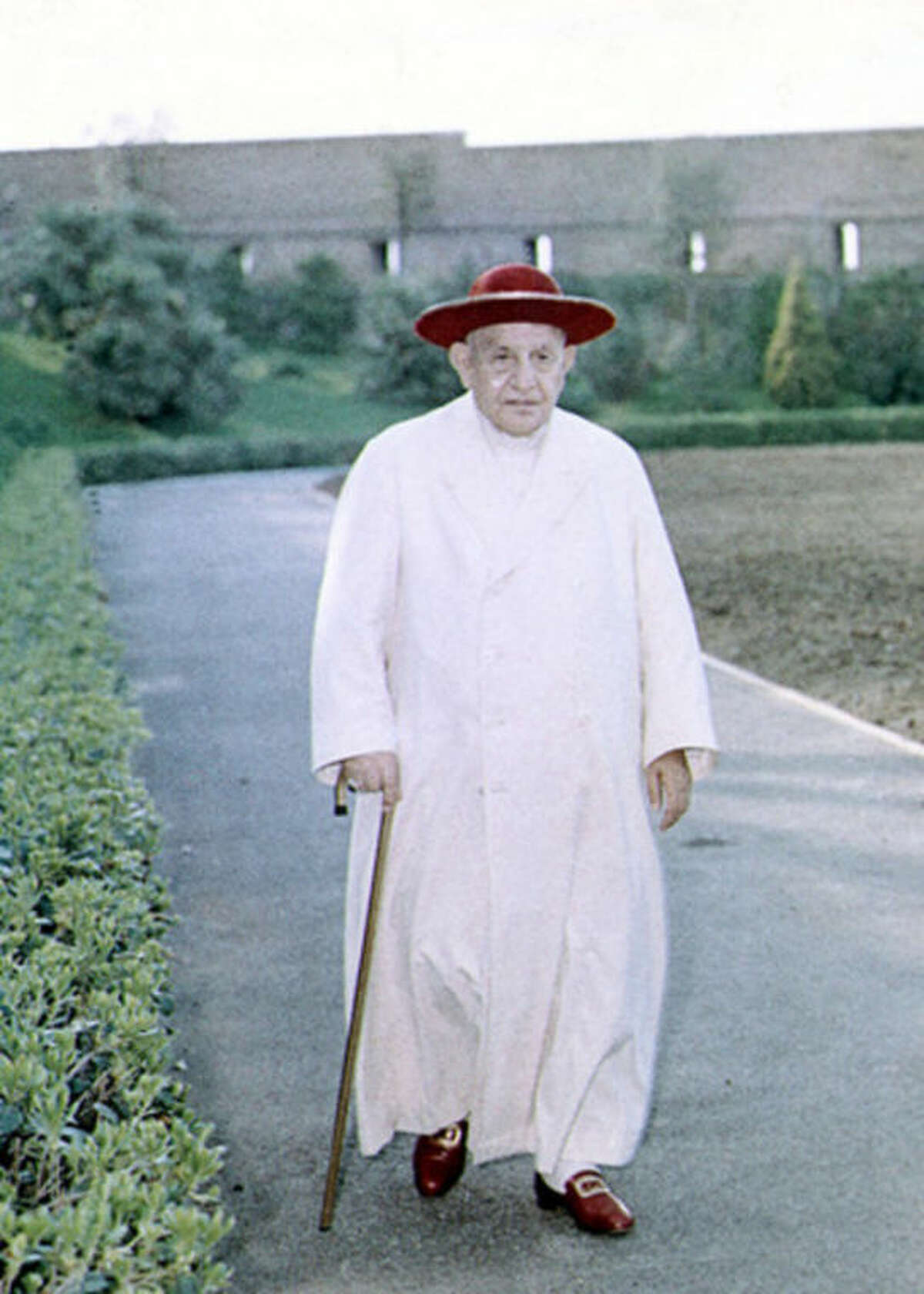 FILE - In this file photo taken on April 15 1963, Pope John XXIII walks in the gardens of the Vatican. Pope Francis has cleared John Paul II for sainthood, approving a miracle attributed to his intercession. Francis also decided Friday, July 5, 2013, to canonize another beloved pope, John XXIII, even though there has been no second miracle attributed to his intercession. The Vatican said Francis approved a decision by cardinals and bishops. The ceremonies are expected before the end of the year. (AP-Photo/HO Vatican)
