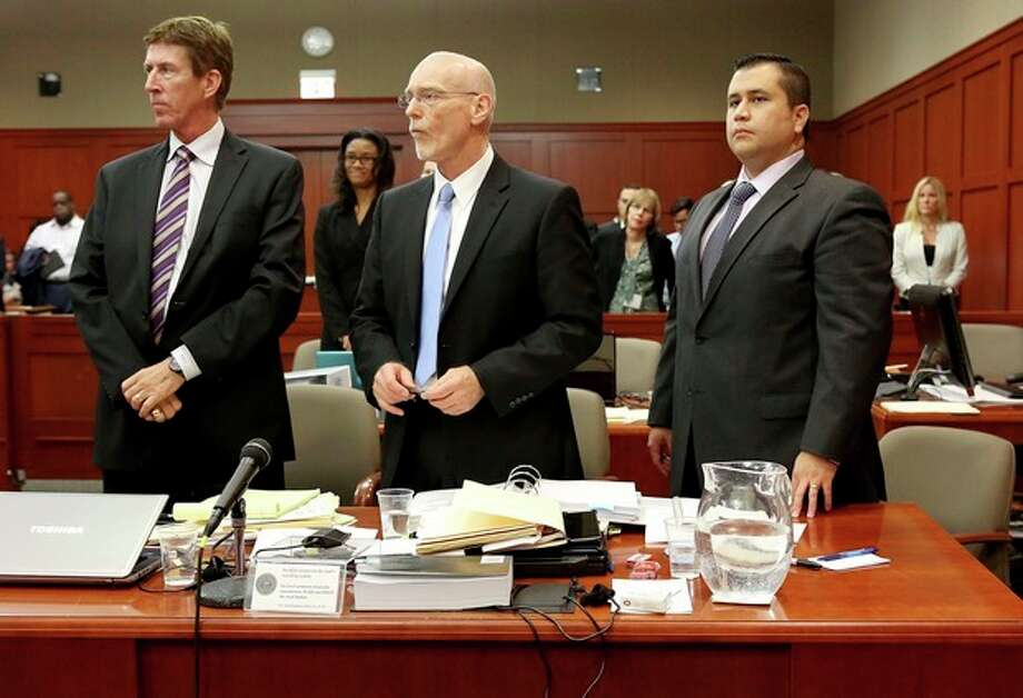 Defense attorneys Mark O'Mara, left, Don West, center, stand with George Zimmerman during Zimmerman's trial in Seminole circuit court, in Sanford, Fla., Wednesday, July 3, 2013. Zimmerman is charged with second-degree murder in the 2012 fatal shooting of slain teen Trayvon Martin. (AP Photo/Orlando Sentinel, Jacob Langston, Pool) / Pool Orlando Sentinel