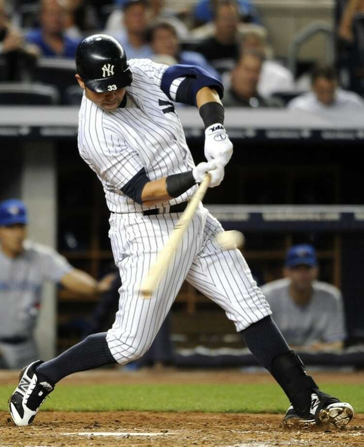 New York Yankees' Nick Swisher hits an RBI single off of Toronto Blue Jays starting pitcher Ricky Romero in the third inning of a baseball game on Tuesday, Aug., 28, 2012, in New York. (AP Photo/Kathy Kmonicek)
