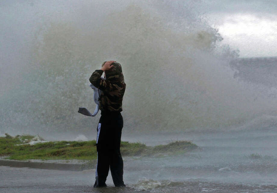 AP photo / The Times-Picayune, John McCuskerMatthew Nicaud braves the wind as waves crash over the seawall of Lake Pontchartrain at Canal Boulevard in New Orleans Tuesday as Isaac approaches. The U.S. National Hurricane Center in Miami said Isaac became a Category 1 hurricane Tuesday with winds of 75 mph. It could get stronger by the time it's expected to reach the swampy coast of southeast Louisiana. / The Times-Picayune