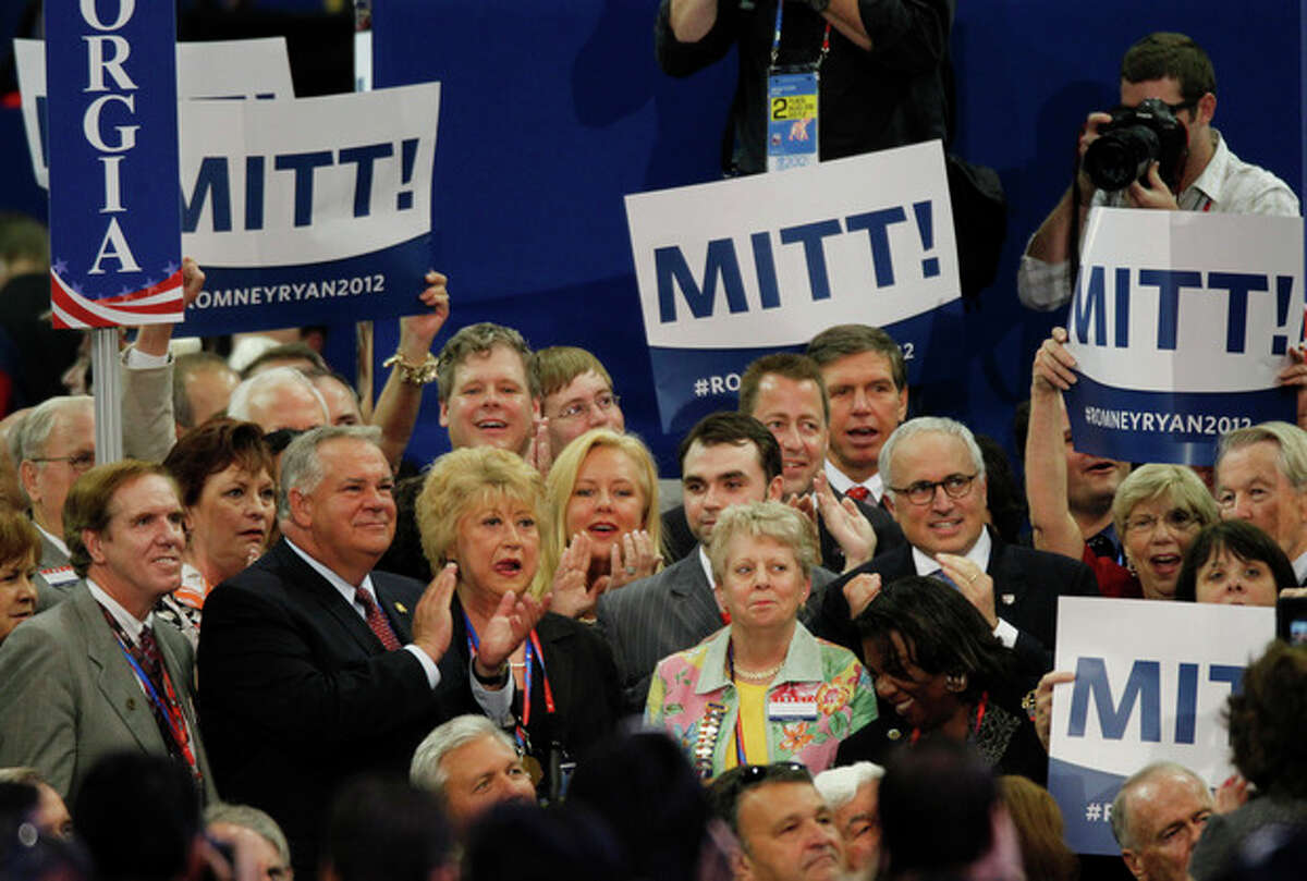 Delegates from the state of Georgia applaud after casting their votes for presidential candidate Mitt Romneyduring the Republican National Convention in Tampa, Fla., on Tuesday, Aug. 28, 2012. (AP Photo/Lynne Sladky)