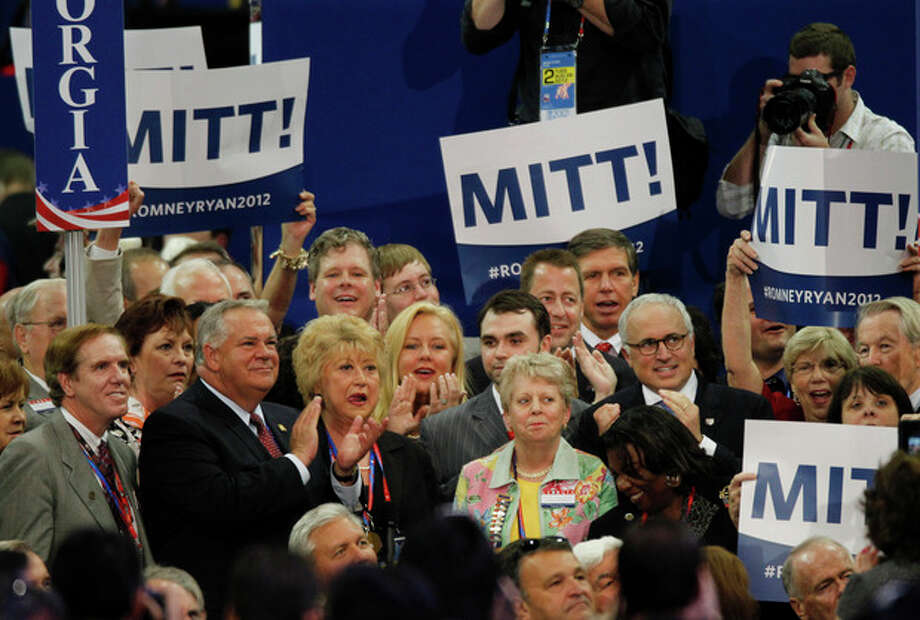 Delegates from the state of Georgia applaud after casting their votes for presidential candidate Mitt Romneyduring the Republican National Convention in Tampa, Fla., on Tuesday, Aug. 28, 2012. (AP Photo/Lynne Sladky) / AP