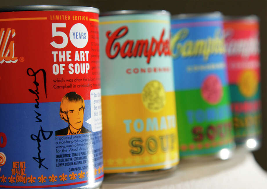 In this photograph taken Friday, August 24, 2012, new limited edition Campbell's tomato soup cans with art and sayings by artist Andy Warhol are displayed at Campbell Soup Company in Camden, N.J. Campbell plans to introduce the special-edition cans of its condensed tomato soup bearing labels reminiscent of the pop artist's paintings at Target stores starting Sunday, Sept. 2, 2012. (Photo/Mel Evans) / AP