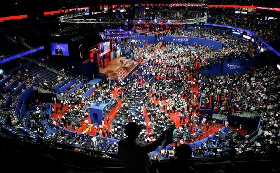 Delegates gather in the Tampa Bay Times Forum during the Republican National Convention in Tampa, Fla., on Tuesday, Aug. 28, 2012. (AP Photo/Jae C. Hong) / AP