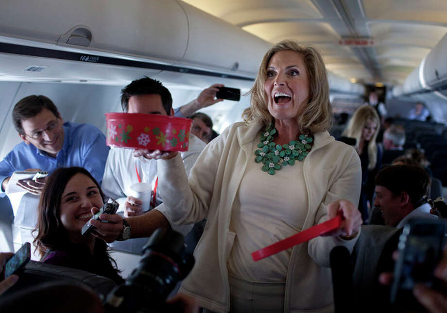 Ann Romney, wife of Republican presidential candidate, former Massachusetts Gov. Mitt Romney hands out cookies during a flight to Tampa, Tuesday, Aug. 28, 2012. (AP Photo/Evan Vucci) / AP
