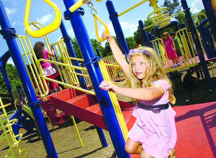 Hour Photo/ Alex von Kleydorff. Springdale School first grader Kelly Dunne swings on the playground during first day of school in Stamford.