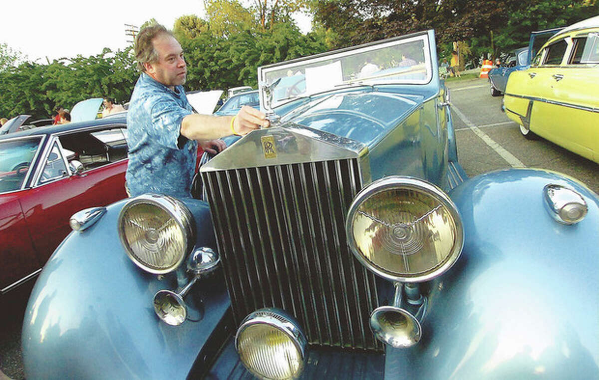 Photo by Alex von Kleydorff Wilton's Bill Merritt straightens the flying lady on his unrestored 1937 Rolls Royce 25/30 Windover Drophead Convertible during the Kiwanis car show in Wilton Center in this file photo. Automobile collectors and enthusiasts are expected to park more than 100 vintage vehicles in Wilton Center on Friday, July 12 for the 13th annual Kiwanis Club Car Show. The free event, from 6-9 p.m. in the Piersall Building's parking lot at 44 Old Ridgefield Road, will feature hot rods, motorcycles, and custom, sport and classic cars, all pre-dating 1980.