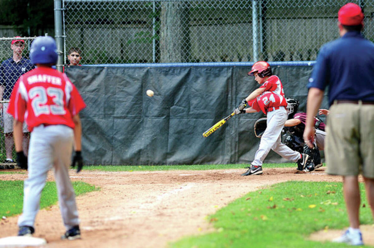 Kyle Dobson hits a two run double for Norwalk LL in their playoff game against Stamford National at Chesnut Hill Park in Stamford Saturday. Hour photo / Erik Trautmann