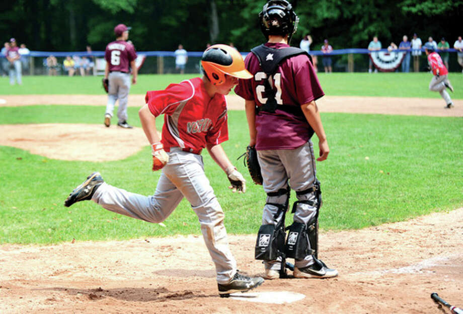 Jimmy Evans crosses the plate for Norwalk LL in their playoff game against Stamford National at Chesnut Hill Park in Stamford Saturday.Hour photo / Erik Trautmann / (C)2013, The Hour Newspapers, all rights reserved