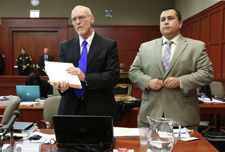 George Zimmerman, right, stands next to one of his defense attorneys, Don West, during his trial in Seminole circuit court, Friday, July 5, 2013 in Sanford, Fla. Zimmerman has been charged with second-degree murder for the 2012 shooting death of Trayvon Martin. (AP Photo/Orlando Sentinel, Gary W. Green, Pool) / Pool Orlando Sentinel