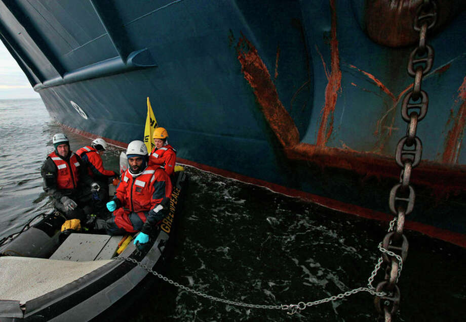 This image made available by environmental organization Greenpeace shows Greenpeace activists chained to the anchor chain of the Anna Akhmatova, the vessel which was carrying Gazprom's workers to the Prirazlomnaya platform, in the Pechora Sea about 620 miles (1,000 kilometers) from the nearest port, Murmansk, a city on the extreme northwestern edge of the Russian mainland, Monday Aug. 27, 2012. Gazprom is pioneering Russia's oil drilling in the Arctic. The state-owned company installed the platform there last year and is preparing to drill the first well. Environmentalists have warned that drilling in the Russian Arctic could have disastrous consequences because of a lack of technology to deal with a possible spill in this remote region. (AP Photo/Denis Sinyakov/Greenpeace, HO) / Greenpeace