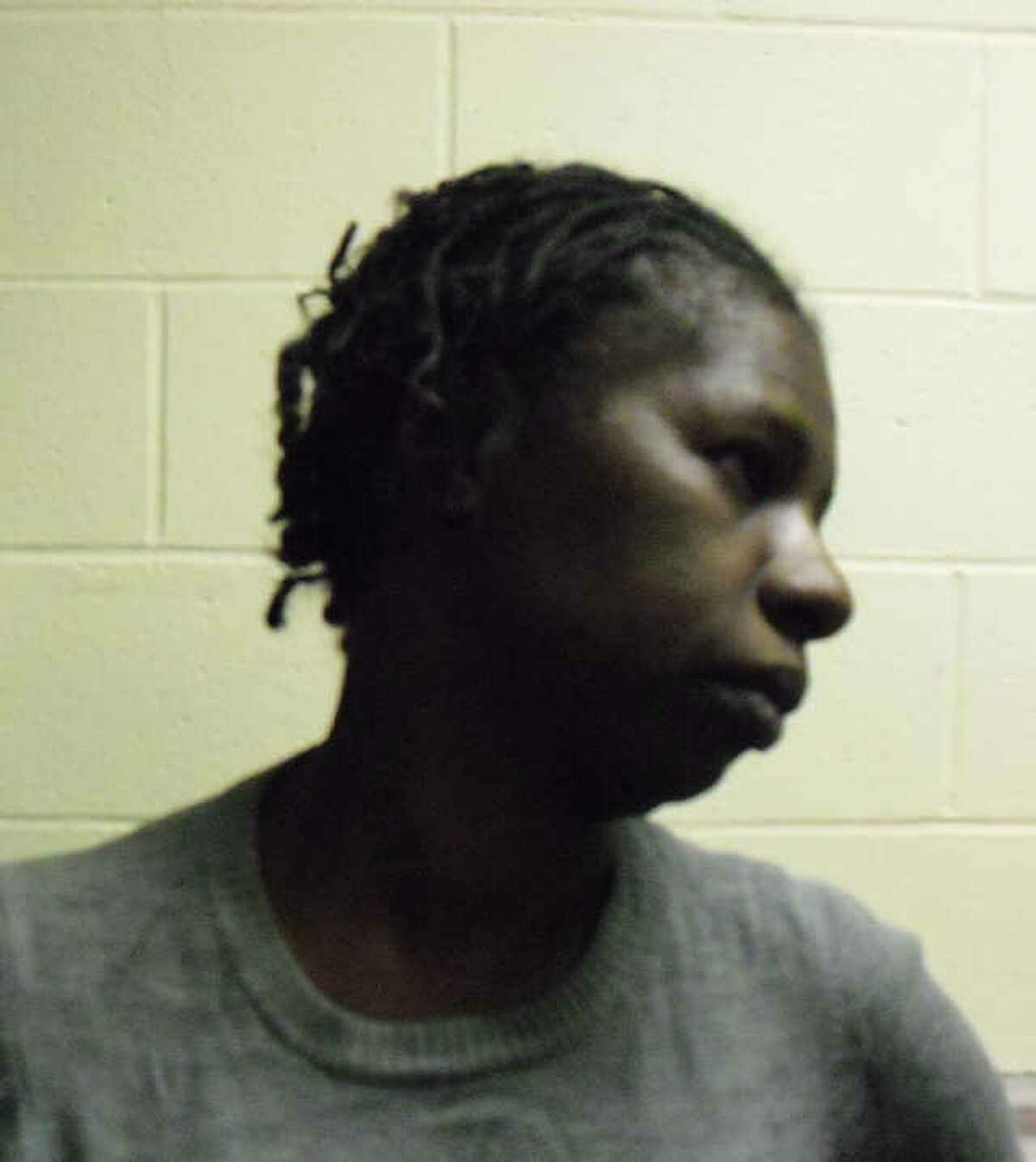 This booking photo provided by the Wilton Police Department shows Theresa Clinding of Hempstead, N.Y. Clinding was arrested last week on charges that she stole from than $5,000 in cash from a Danbury Road dry cleaning business in October 2011.