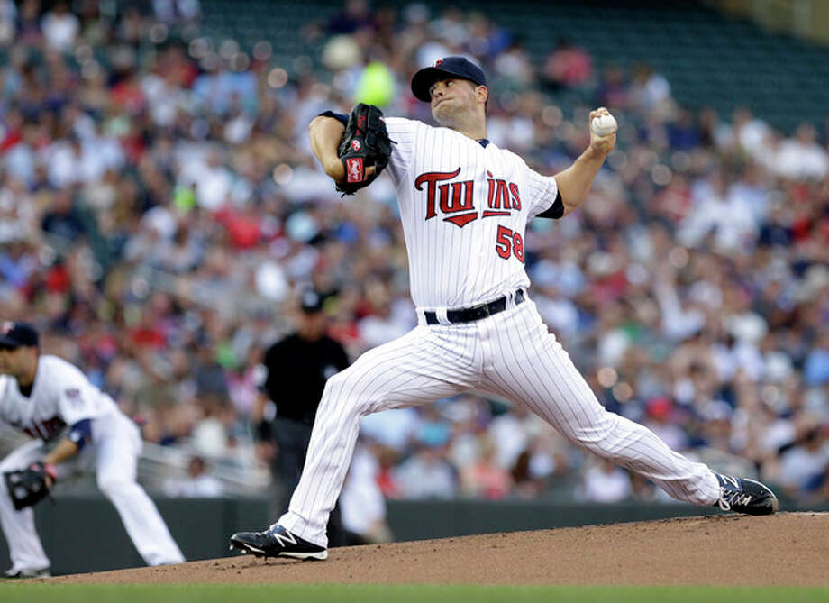 Minnesota Twins pitcher Scott Diamond throws against the New York Yankees in the first inning of a baseball game, Monday, July 1, 2013, in Minneapolis. (AP Photo/Jim Mone) / AP