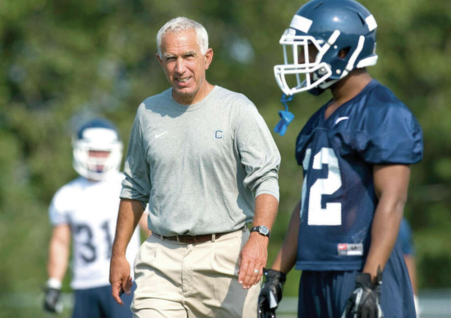 AP photoUConn coach Paul Pasqualoni, left, watches his players during an early season practice. UConn will finally see another team on the other side of the line of scrimmage when it opens its season Thursday night against UMass at Rentschler Field. / FR125654 AP