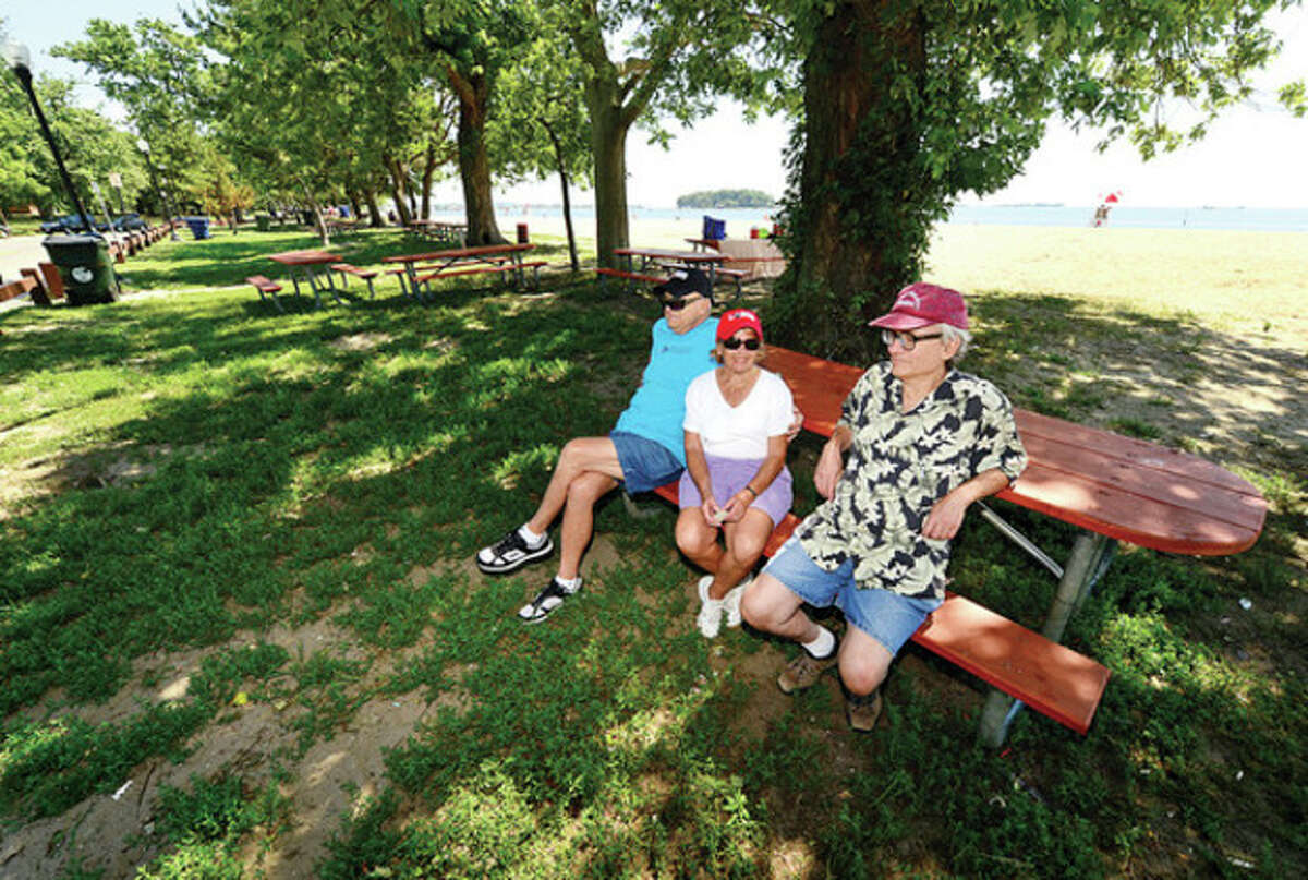 Irwin Weiner, Lauree Gable and Fred Weiner enjoy the day at a clean Shady Beach Friday following the independence Day holiday. Last year there were complaints about the Recreation and Parks Department slow respose to trash clean up.Hour photo / Erik Trautmann
