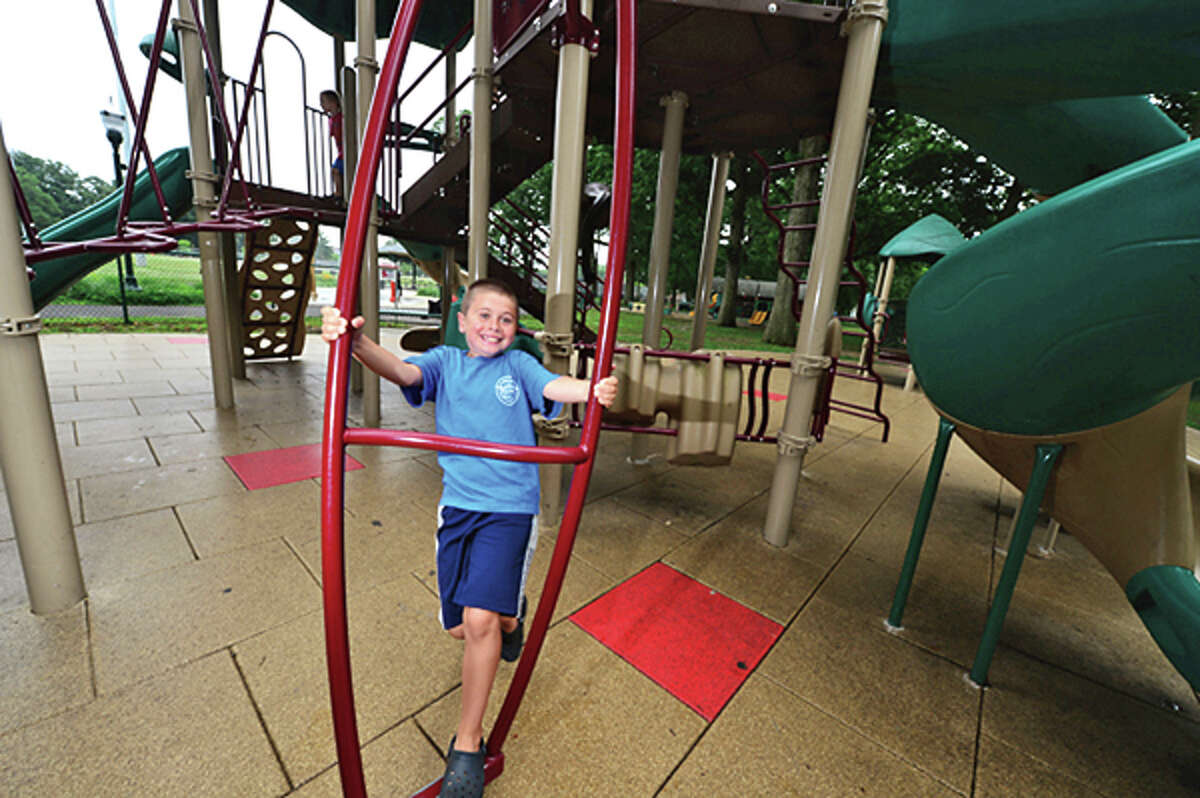 12 tearold Branden McDermott plays on the new playground on Thursday when the renovated Scalzi Park was officially reopened. Hour photo / Erik Trautmann