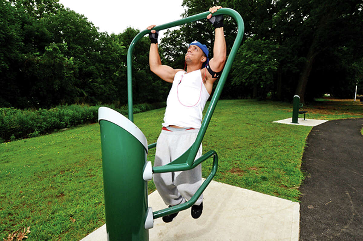 Will Reyes uses the new Health Beat excercise equipment on Thursday when the renovated Scalzi Park was officially comemorated. Hour photo / Erik Trautmann