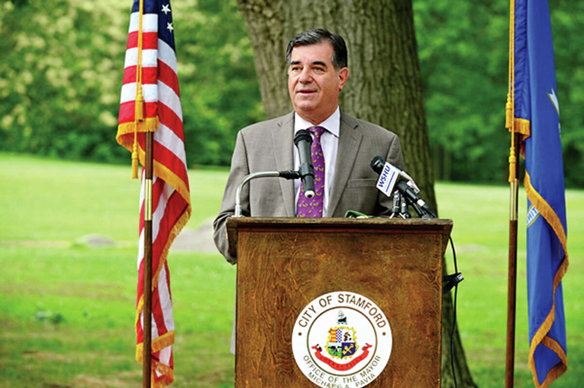 Mayor Michael Pavia speaks on Thursday when the renovated Scalzi Park was officially reopened. Hour photo / Erik Trautmann