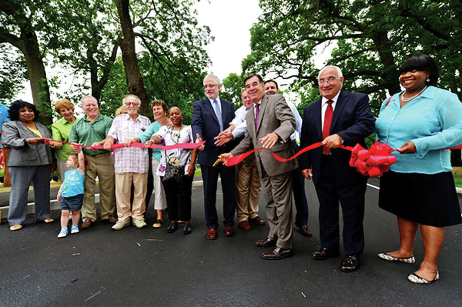 Officials and Mayor Michael Pavia cut the ribbon on Thursday when the renovated Scalzi Park was officially reopened. Hour photo / Erik Trautmann / (C)2013, The Hour Newspapers, all rights reserved