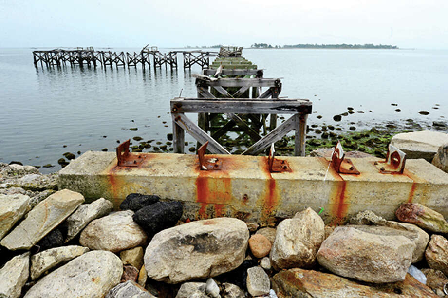 Department of Recreation and Parks has state approvals to proceed with rebuilding of seawall and pier at Calf Pasture Beach which is to begin later this summer. Hour photo / Erik Trautmann / (C)2013, The Hour Newspapers, all rights reserved