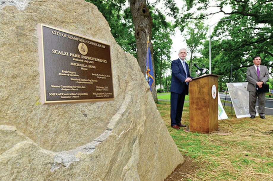 Hour photo / Erik TrautmannAbove, President of the Board of Representatives, Randall Sigen speaks on Thursday when the renovated Scalzi Park was officially reopened. / (C)2013, The Hour Newspapers, all rights reserved