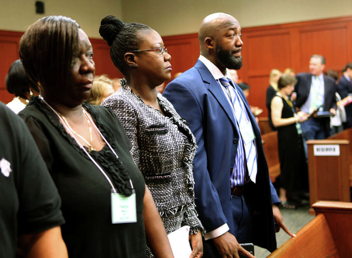 The parents of Trayvon Martin, Sybrina Fulton, center, and Tracy Martin, right, stand with Trayvon Martin's Aunt, Stephanie Fulton Sands, left, as they wait for the jury's arrival in the courtroom at the start of the George Zimmerman trial on the 17th day, in Seminole circuit court, Tuesday, July 2, 2013 in Sanford, Fla. Zimmerman has been charged with second-degree murder for the 2012 shooting death of Trayvon Martin. (AP Photo/Orlando Sentinel, Joe Burbank, Pool)