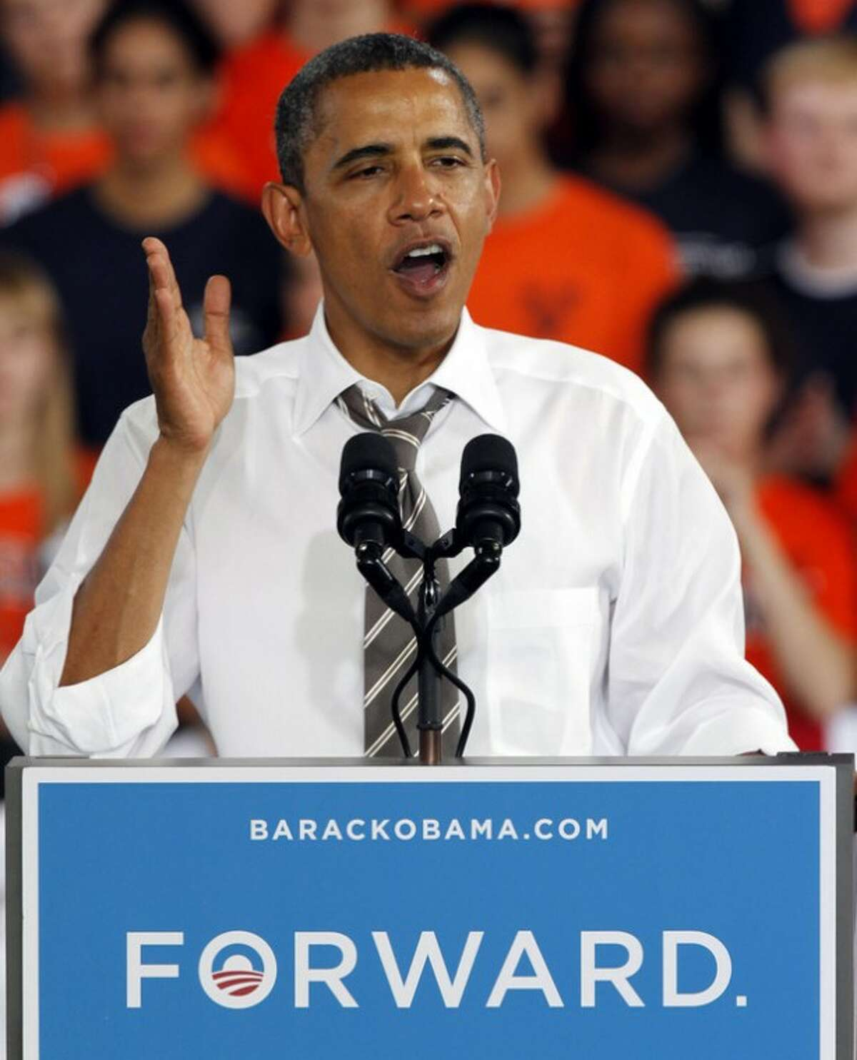 President Barack Obama gestures during a rally in Charlottesville, Va., Wednesday, Aug. 29, 2012. (AP Photo/Steve Helber)