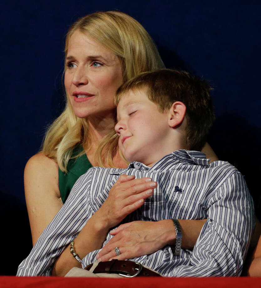 Sam Ryan sleeps in his mother's arms while Republican vice presidential nominee, Rep. Paul Ryan speaks during the Republican National Convention in Tampa, Fla., on Wednesday, Aug. 29, 2012. (AP Photo/Charlie Neibergall) / AP