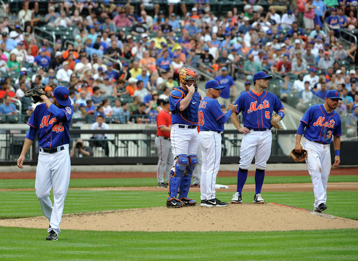 New York Mets starting pitcher Zack Wheeler (45) walks to the dugout after being taken out of the baseball game against the Washington Nationals' in the fifth inning by manager Terry Collins (10) at Citi Field on Sunday, June 30, 2013 in New York. (AP Photo/Kathy Kmonicek)