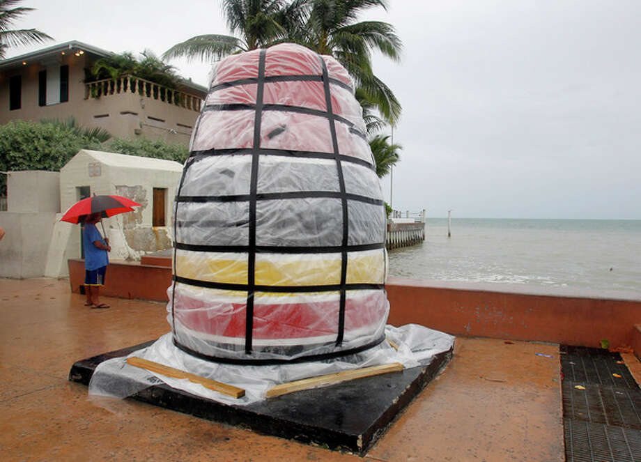 The southernmost point marker is covered in plastic sheeting in Key West, Fla., Saturday, Aug. 25, 2012, in preparation for Tropical Storm Isaac, Saturday, Aug. 25, 2012. Isaac's winds are expected to be felt in the Florida Keys by sunrise Sunday morning. (AP Photo/Alan Diaz) / AP