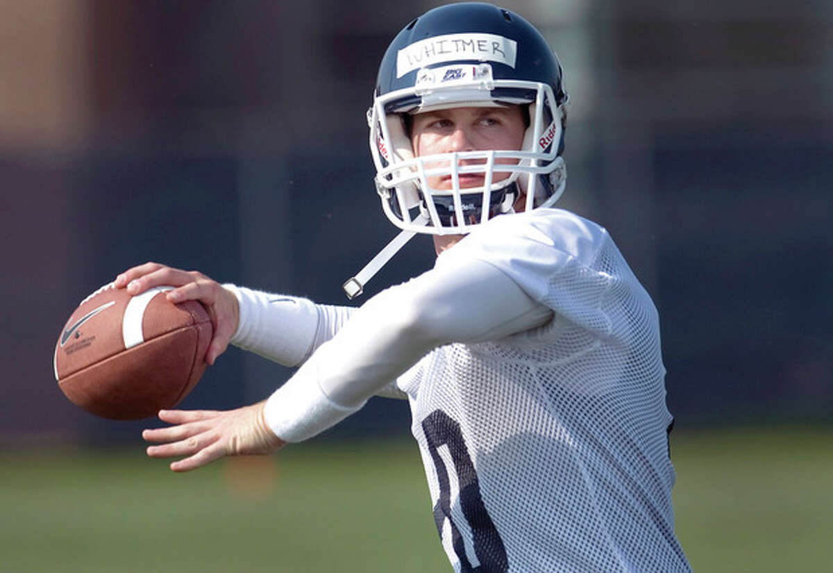 FILE - In this Aug. 3, 2012, file photo, Connecticut quarterback Chandler Whitmer throws during the team's first NCAA college football practice of the season in Storrs, Conn., Connecticut opened practice with Whitmer, a junior-college transfer, as the No. 1 quarterback on the depth chart. Whitmer got the nod this week on the strength of his performance in UConn's spring game, in which he completed 18 of 27 passes for 187 yards (AP Photo/Jessica Hill, File)